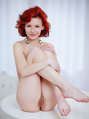 Redhead Zarina A poses in her birthday suit