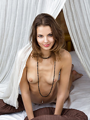 Brown-haired seductress, Sandra Lauver, with smoldering eyes, naughty smile, and sensual poses