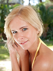 Blue-eyed babe Tracy A with tanned skin and cute smile lounges after by the shade after taking a dip in the pool - Pics