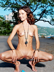 Divina A's breathtaking beauty and sexy body stands out in this outdoor shoot with photographer Leonardo