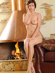 Suzanna shows off her magnificent breasts, slim waist, shavd pussy, and long legs by the fireplace