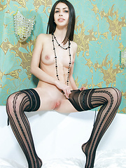 Flora C\'s long and slender physique accentuated by her black thigh-high fishnet stockings - Pics
