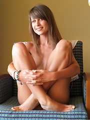 Mia loves lounging on the chair,   naked, showcasing her innocent and   cute face, and youthful, delectable body.