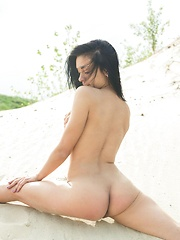 Amidst the the sea glaring brightly   from the midnoon sun, Aprilia entices   us with an appetizing display of her   body\'s scrumptious assets, and frolics   among the sandy beach, uninhibited and   carefree. - Pics