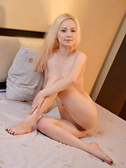 Gorgeous Nubile plays with her silky and sweet pink pussy - Pics