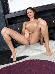 Fresh amateur gives her shaved puffy pussy a good finger fuck - Pics