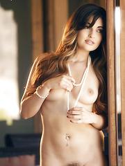Natasha Malkova gets hot and bothered while touching her body - Pics