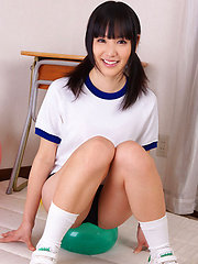 Yuri Hamada Asian in sports equipment plays with balloons a lot