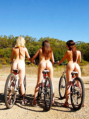 Three sexy girls ride bikes in the park naked watch nice ass and boobs get sucked and fucked - Pics
