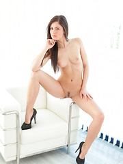 Petite bombshell Caprice A posing seductively in her black body-hugging lingerie dress and sparkly stiletto heels. - Pics