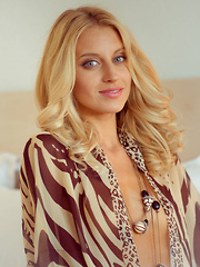 Blonde hottie Delfina A wearing an animal print chiffon robe and sheer panty that compliments her beautiful tanned body and lusty appeal.