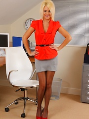 Gorgeous blonde teases in her office uniform and red lingerie - Pics