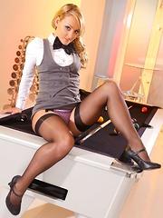 Pool hustler Sara wearing tight fitting skirt suit and black stockings - Pics