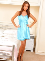 The beautiful Sammie Pennington slips out of her blue silk night gown.