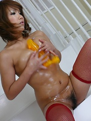 Oiled up Japanese babe loves to fuck herself - Pics