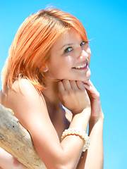 Pretty redhead named Violla basks under the morning sun, her smooth skin is glowing, and her enchanting smile brighten up her beautiful face.