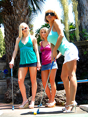 Amazing long leg lesbian babes share a game of golf before getting together for a hot lesbo fuck 3some
