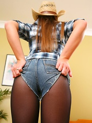 Sexy cowgirl in a tight checked shirt and tiny ripped denim hotpants. (Non Nude) - Pics