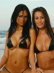 Karla and her friend get all wet at the beach