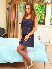 Jamie A looks gorgeous in her dark blue minidress and cream high heels (Non Nude)