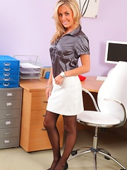 Beautiful secretary slowly teases her way of the satin blouse