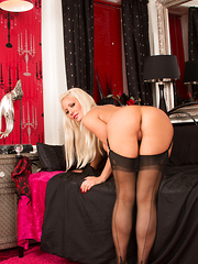 Hot blonde MILF in black stockings spreads open her juicy shaved pussy - Pics