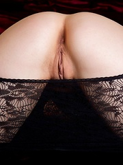 Feeona A tease in and out of her see through lacy black body suit.