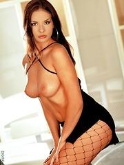 Nika - looks stunning in black fishnets - Pics