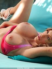Jenna Presley - barely fits in her little pink bikini - Pics
