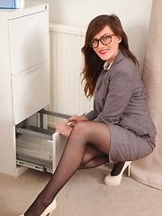 Sexy specced brunette in black stockings - Pics
