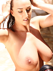 You have seen Stacey's photos in this saucy outfit but now it is time for behind-the-scenes! For this one, Stacey takes a warm outdoor shower in the glorious sunshine and basks in the glow of of the afternoon light, allowing us to bask in her glory!