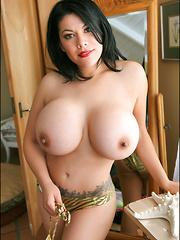 Super busty Latina Ana poses huge tits at the pool - Pics