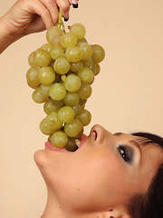Domino masturbates with Grapes