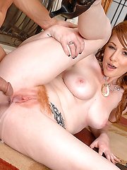 Super hot red head gets her wet red bush pounded by a hard cock then takes the load to her face in these sexy pics