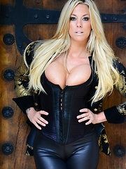 xoGisele wears tight shiny black leggings and a sexy corset as she strip teases and plays with her dildo - Pics